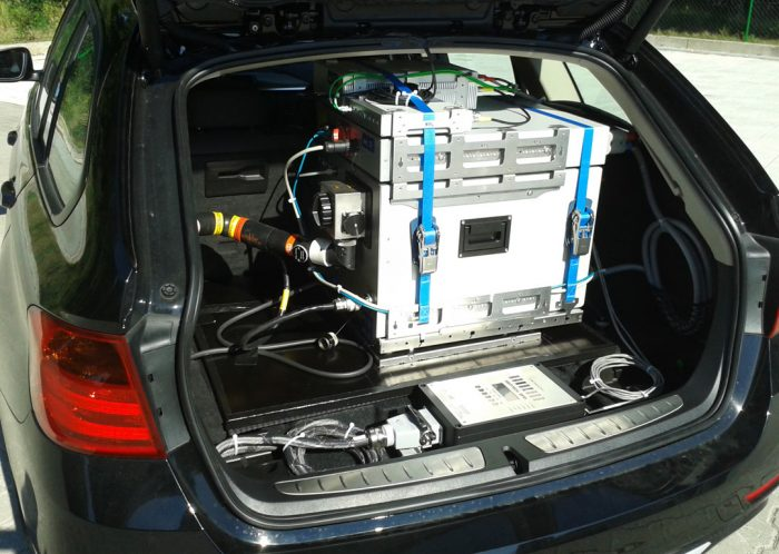 A car with an open boot to show an emissions measuring unit